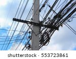 Poles And Wires With Blue Sky