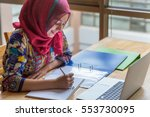 muslim woman working with... | Shutterstock . vector #553730095