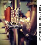 many metal taps with the wooden ... | Shutterstock . vector #553751851