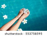beautiful female foot in... | Shutterstock . vector #553758595