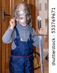 Small photo of Kolomna, Russia - January 03, 2017: boy trying armor from the Blacksmith Settlement museum collection by Andrey Kopylov, aka linkpusher