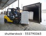 forklift in warehouse loading... | Shutterstock . vector #553790365