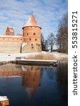 Small photo of Winter view through the Lake Galve to the one of the corner towers and the forecastle wall of Trakai Island Castle situated in the historical town Trakai, Lithuania, Europe