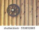 old time wooden wheel on wall ... | Shutterstock . vector #553852885