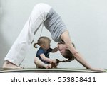 hatha yoga fitness mother with... | Shutterstock . vector #553858411