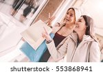 happy woman with shopping bags... | Shutterstock . vector #553868941