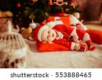 the small baby lies near... | Shutterstock . vector #553888465