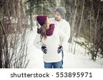 a pregnant couple have fun in... | Shutterstock . vector #553895971