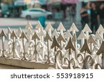 White Spiky Metal Fence In The...