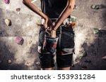 climber woman coating her hands ... | Shutterstock . vector #553931284