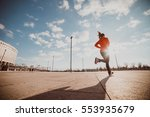 a jogging woman runs on the... | Shutterstock . vector #553935679