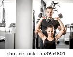 young adult fitness couple.... | Shutterstock . vector #553954801