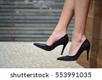 white woman wearing a black... | Shutterstock . vector #553991035