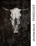 Small photo of The ghostly skull of a bull on a black background. Creative photography