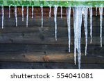 big icicles on a freezing... | Shutterstock . vector #554041081