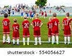 boys play soccer match.... | Shutterstock . vector #554056627