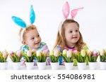 happy children celebrate easter ... | Shutterstock . vector #554086981