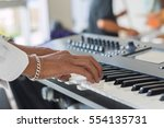 musician playing on keyboards. | Shutterstock . vector #554135731