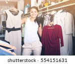 caucasian girl chousing dress... | Shutterstock . vector #554151631