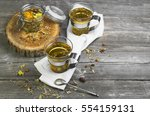 two glass cups of herbal tea....   Shutterstock . vector #554159131