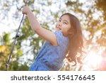 happy little asian girl playing ... | Shutterstock . vector #554176645