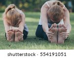 mother and daughter doing yoga... | Shutterstock . vector #554191051