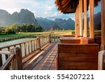 green rice fields and mountains ... | Shutterstock . vector #554207221