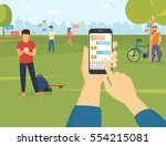 human hand holds smart phone... | Shutterstock .eps vector #554215081