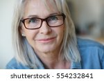 portrait of senior woman with... | Shutterstock . vector #554232841