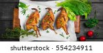 roasted quail on a wooden tray. ... | Shutterstock . vector #554234911