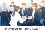 colleagues  discussing about... | Shutterstock . vector #554246314