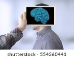 scanning brain with tablet pc | Shutterstock . vector #554260441