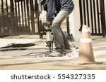 worker man mason drilling... | Shutterstock . vector #554327335