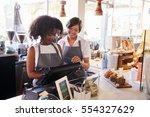 new employee receives training... | Shutterstock . vector #554327629