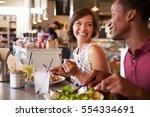 couple enjoying lunch date in...   Shutterstock . vector #554334691