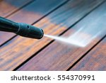 cleaning terrace with a power... | Shutterstock . vector #554370991