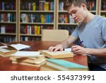 serious guy rewriting... | Shutterstock . vector #554373991