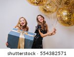portrait two joyful excited... | Shutterstock . vector #554382571