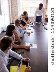 businesspeople listening to... | Shutterstock . vector #554390131