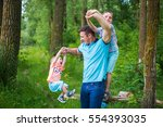 father playing with children on ... | Shutterstock . vector #554393035