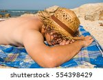 A Man Sunbathing On The Beach