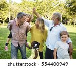 family walking field nature... | Shutterstock . vector #554400949