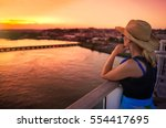 woman watching sunset on cruise ... | Shutterstock . vector #554417695