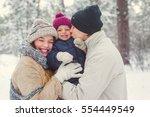 family walk in the winter woods ... | Shutterstock . vector #554449549