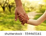 the parent holds the hand of a... | Shutterstock . vector #554465161