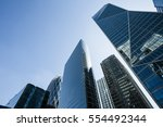 Small photo of Skyscrapers with glass facade. Modern buildings in Paris business district. Concepts of economics, financial, future. Copy space for text. Dynamic composition. Toned