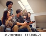 group of friends playing video... | Shutterstock . vector #554508109