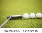 putter and golf balls on the... | Shutterstock . vector #554522515