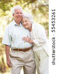 senior couple walking in park | Shutterstock . vector #55453261