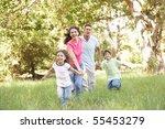 family enjoying walk in park | Shutterstock . vector #55453279